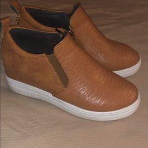 White sole faux camel leather shoe